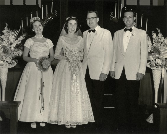 The whole wedding party.  Mom looks beautiful in her wedding dress. Wedding dress restoration made her gown gorgeous again.