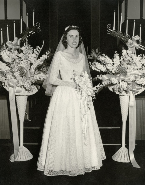 Emma Hulett on her wedding day. Wedding dress restoration will allow someone else to wear her gown again someday.