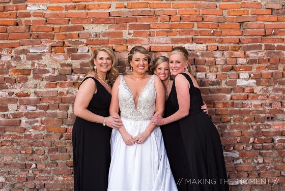 Milisa and bridesmaid enjoy her wedding day. Wedding dress preservation will keep her gown beautiful.
