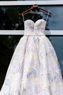 Loren's something blue is on her wedding dress.