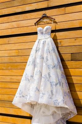 Loren's gorgeous Lazaro wedding dress will be kept lovely with expert wedding dress preservation.