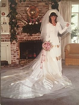 Monette in her mother's wedding gown at her own wedding in 1983.