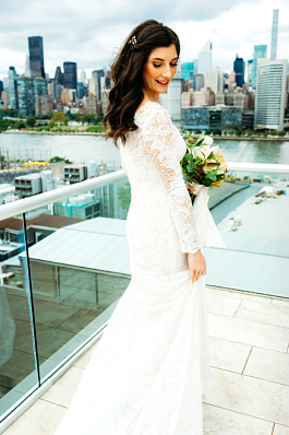 Brittany's Ivory and nude synthetic Atelier Pronovias wedding dress with lace overlay