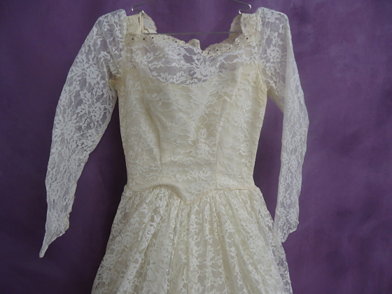 Front top and sleeves of dress before wedding gown restoration
