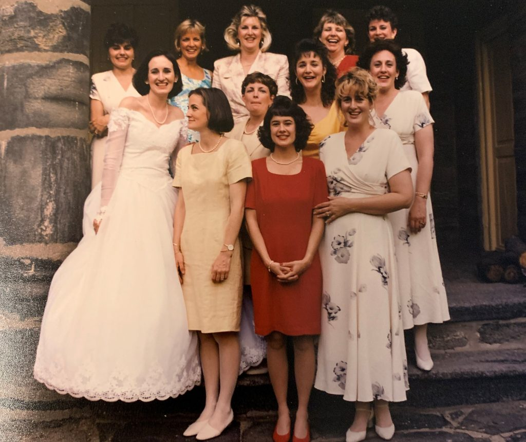 Noreen in her wedding gown with her friends during wedding reception